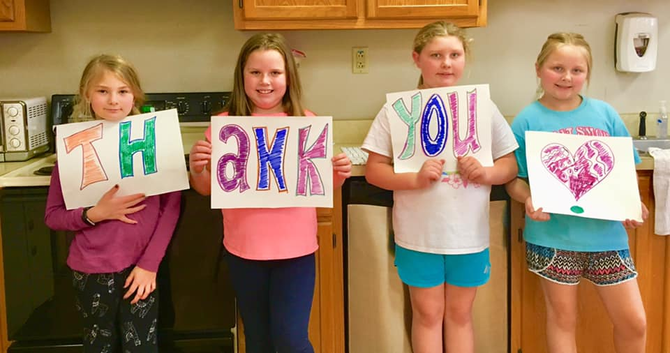 children with thank you sign