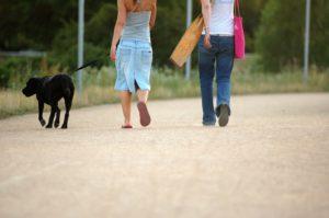 women walking with dog