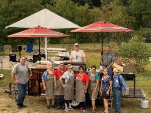 volunteers at an outdoor cooking demonstration